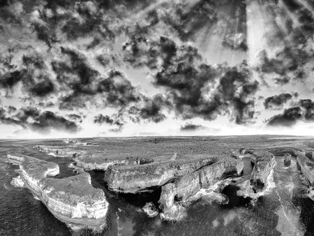 ard: Black and white aerial view of Loch Ard Gorge Coastline - Australia.