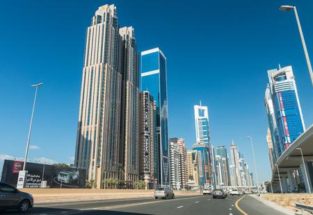 annually: DUBAI - NOVEMBER 22, 2015: City skyline on a beautiful day. Dubai attracts more than 10 million tourists annually.