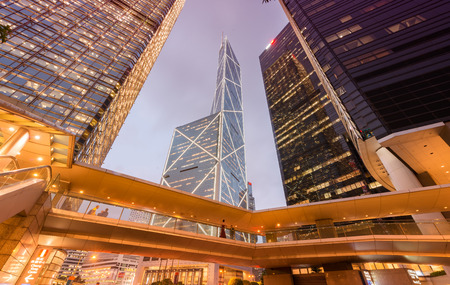 annually: HONG KONG - APRIL 7, 2014: Hong Kong night skyline. The city attracts more than 30 million people annually.