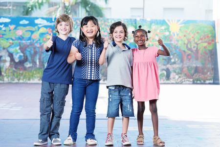 Happy children at school. Multi race classroom enjoying life. Integration concept.
