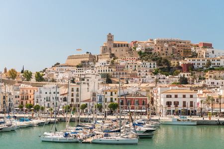 preferred: IBIZA, SPAIN - JUNE 4, 2015: City skyline from a departing ferry boat. Ibiza is a preferred summer destination for tourists. Editorial