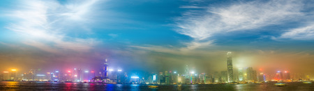 ifc: Hong Kong skyline from Kowloon. Night lights with all ads removed. Stock Photo