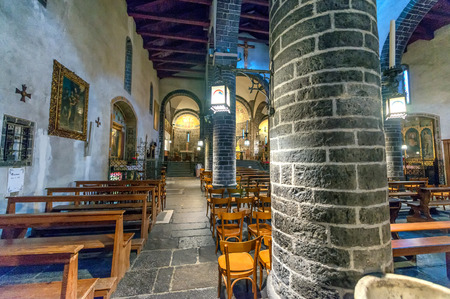 san giacomo: BELLAGIO, ITALY - MARCH 4, 2015: Interior of San Giacomo Cathedral. It was built around 1100.