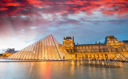art museum: PARIS - JUNE 17, 2014: Beautiful sunset over Louvre Museum architecture. It is one of the worlds largest museums and a historic monument. Editorial