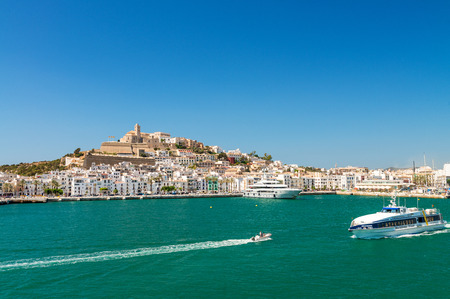 departing: IBIZA, SPAIN - JUNE 4, 2015: City skyline from a departing ferry boat. Ibiza is a preferred summer destination for tourists. Editorial