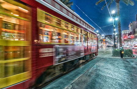 annually: NEW ORLEANS - FEBRUARY 9, 2016: City streets and skyline. New Orleans attracts 10 million tourists annually.