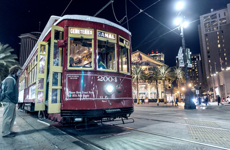 canal street: NEW ORLEANS - FEB 11: People travel with the Street car in Canal street at night on February 11, 2016 in New Orleans, USA. It is the oldest continually operating street car line in the world. Editorial