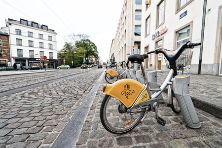 Bruxelles: BRUXELLES - MAY 1, 2015: Public bike parking. Going by bike is a great way to enjoy the city. Editorial