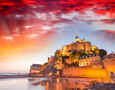 saint: Stunning sunset over Mont Saint Michel, France. Editorial
