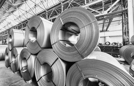 alloy: Steel coils inside a factory.