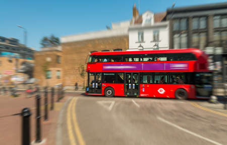 slow lane: Blurred view of fast moving Double Decker Bus, London.
