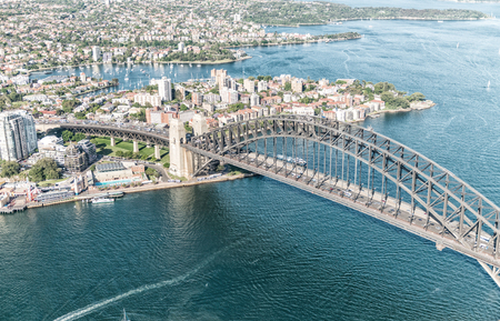 buildings city: Sunset over Sydney Harbour, helicopter view. Stock Photo
