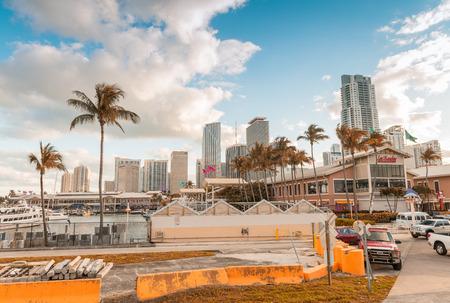 10 12: MIAMI - JANUARY 12, 2016: Miami skyline at dusk. The city attracts 10 million tourists annually.