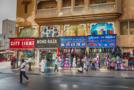 visitors area: DUBAI - OCTOBER 21, 2015: Street of Deira area on a sunny day. Dubai attracts 15 million visitors annually.