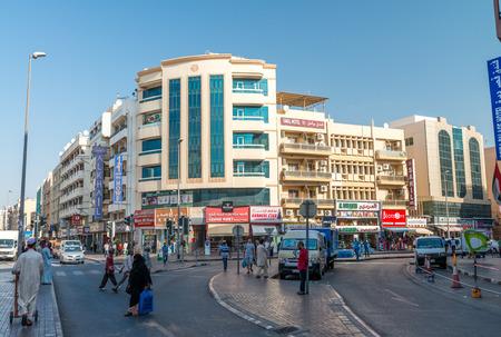 bastakiya: DUBAI - OCTOBER 21, 2015: Street of Deira area on a sunny day. Dubai attracts 15 million visitors annually.