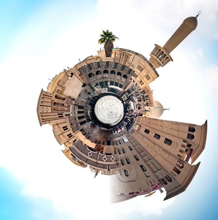 blue sphere: Planet Old Dubai - Miniature planet of Old Dubai, with ancient buildings and attractions of the city. Stock Photo