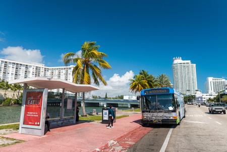 annually: MIAMI BEACH - JANUARY 12, 2016: Miami skyline at dusk. The city attracts 10 million tourists annually.