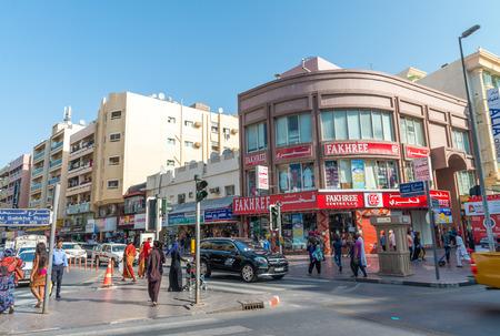 bastakiya: DUBAI, OCTOBER 21, 2015: People on the street of Deira area in Dubai, UAE. Deira is an old commercial center of Dubai with many traditional arabic shops and biggest street market.