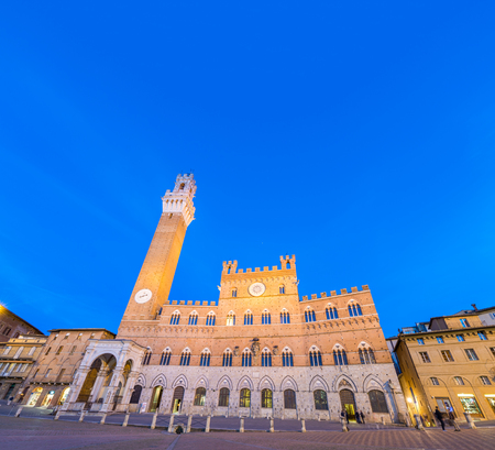palazzo: Piazza del Campo at sunset with Palazzo Pubblico, Siena, Italy.