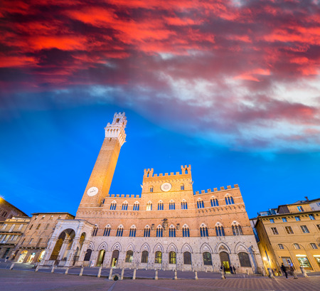 Piazza del Campo at sunset with Palazzo Pubblico, Siena, Italy.