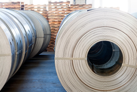 coils: Steel coils stacked in a warehouse. Stock Photo
