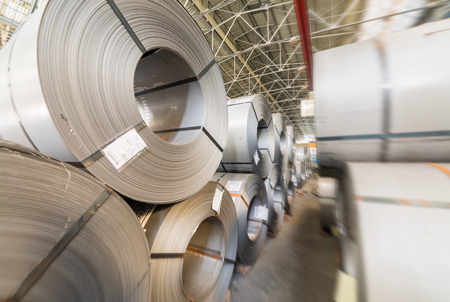 alloy: Steel coils stacked in a warehouse. Stock Photo