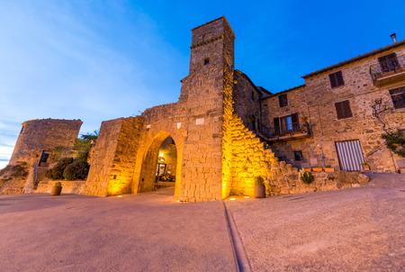 monticchiello: Medieval entrance of Monticchiello at sunset, Tuscany. Stock Photo