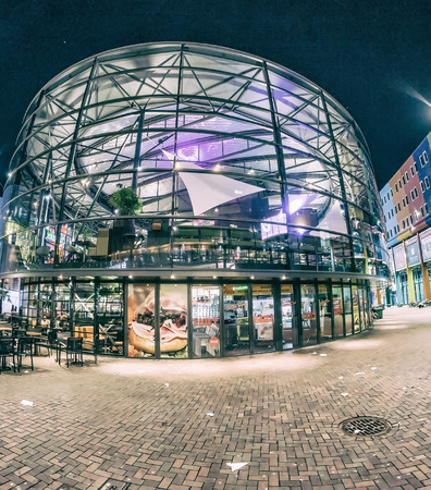 preferred: AMSTERDAM - APRIL 27, 2015: ArenA boulevard at night on Kings day. Amsterdam is a preferred tourist european destination. Editorial