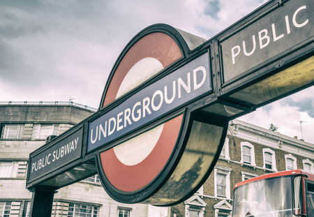 billion: LONDON - JULY 2, 2015: London Underground station entrance. London Underground is the 11th busiest metro system worldwide with 1.1 billion annual rides. Editorial