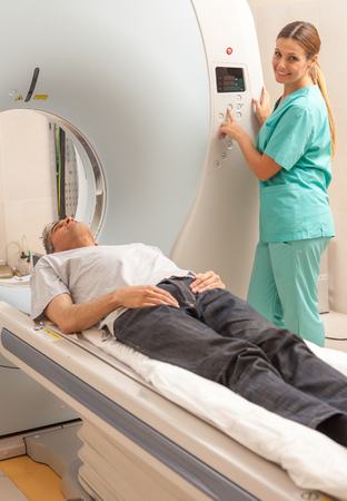 mri scan: Happy patient undergoing mri scan at hospital. Stock Photo