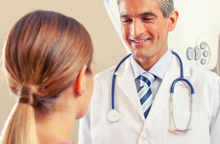 reassuring: Doctor reassuring female patient. Health and hospital concept.