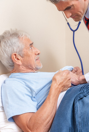hospital patient: Doctor and patient. Measurement of blood pressure in a hospital.