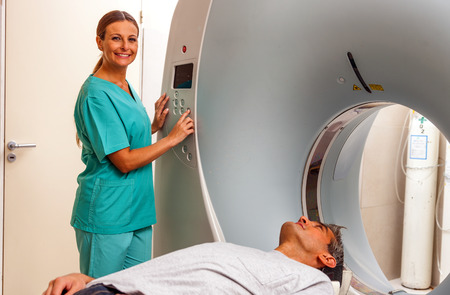radiotherapy: Happy male patient undergoing CT scan.