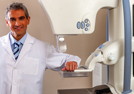 reassurance: Happy doctor giving security and reassurance. Health and hospital concept. Stock Photo