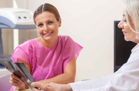 reassuring: Female doctor reassuring patient with test results.