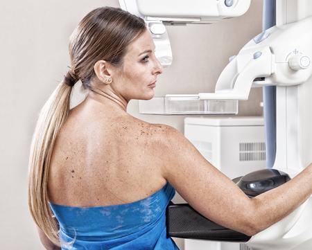 hospital patient: Patient undergoing scan test in hospital room.