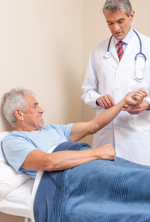 Hospital care: Blood pressure measuring. Doctor and patient. Hospital concept. Health care Stock Photo