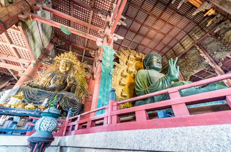 sheltering: NARA, JAPAN - MAY 2016: People walk to the great hall of Buddhist Todai-ji temple in Nara, sheltering the Great Daibutsu Buddha statue Editorial