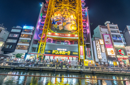 tourist spots: OSAKA, JAPAN - MAY 28: Dotonbori street in Osaka on May 28, 2016. One of the famous tourist spots in Osaka. People come to see the billboards and well design shop logo.