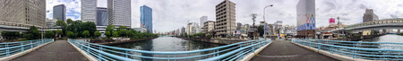 OSAKA, JAPAN - MAY 2016: Panoramic 360 degrees city view along the river. Osaka attracts 3 million visitors every year.