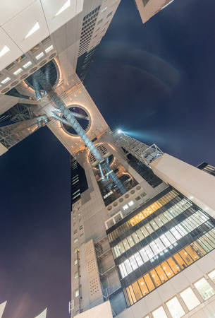 restraints: OSAKA, JAPAN - MAY 28, 2016: The Umeda Sky Building was originally designed as a 4 towered-structure, but was scaled back due to economic restraints.