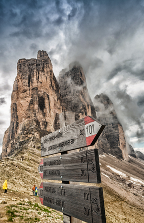 Three Peaks of Lavaredo trail. Signs and mountains, Dolomites - Italy. Фото со стока
