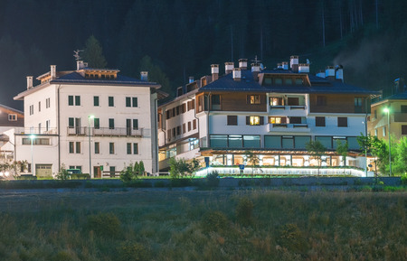 Aronzo at night, Italy. Town center in the heart of Dolomites. Stock Photo