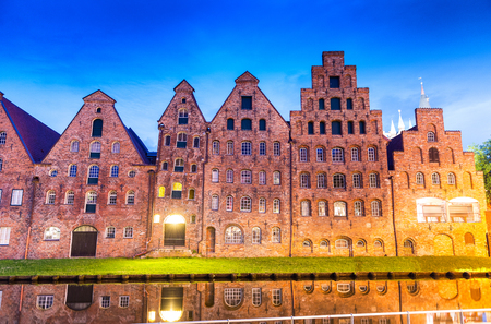 trave: Salzspeicher (salt storehouses) of Lubeck at night, Germany. Historic brick buildings on the Upper Trave River..