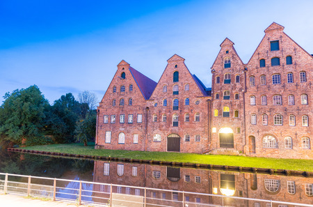 Salzspeicher (salt storehouses) of Lubeck at night, Germany. Historic brick buildings on the Upper Trave River..