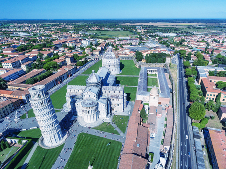 Magnificence of Miracles Square from helicopter, aerial view of Pisa skyline, Tuscany, Italy. 免版税图像