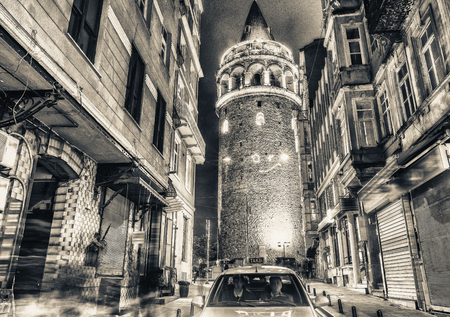 magnificence: Magnificence of Galata Tower at night with taxi on the street, Istanbul - Turkey.