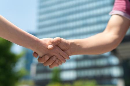 informal: Informal handshake between man and woman.