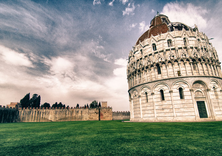 miracle square: Baptistery in the Miracle Square of Pisa, landmark in Pisa, Italy Stock Photo