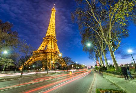 annually: PARIS - NOVEMBER 29, 2012: Illumination of Eiffel Tower at night. Paris attracts 30 million people annually. Editorial